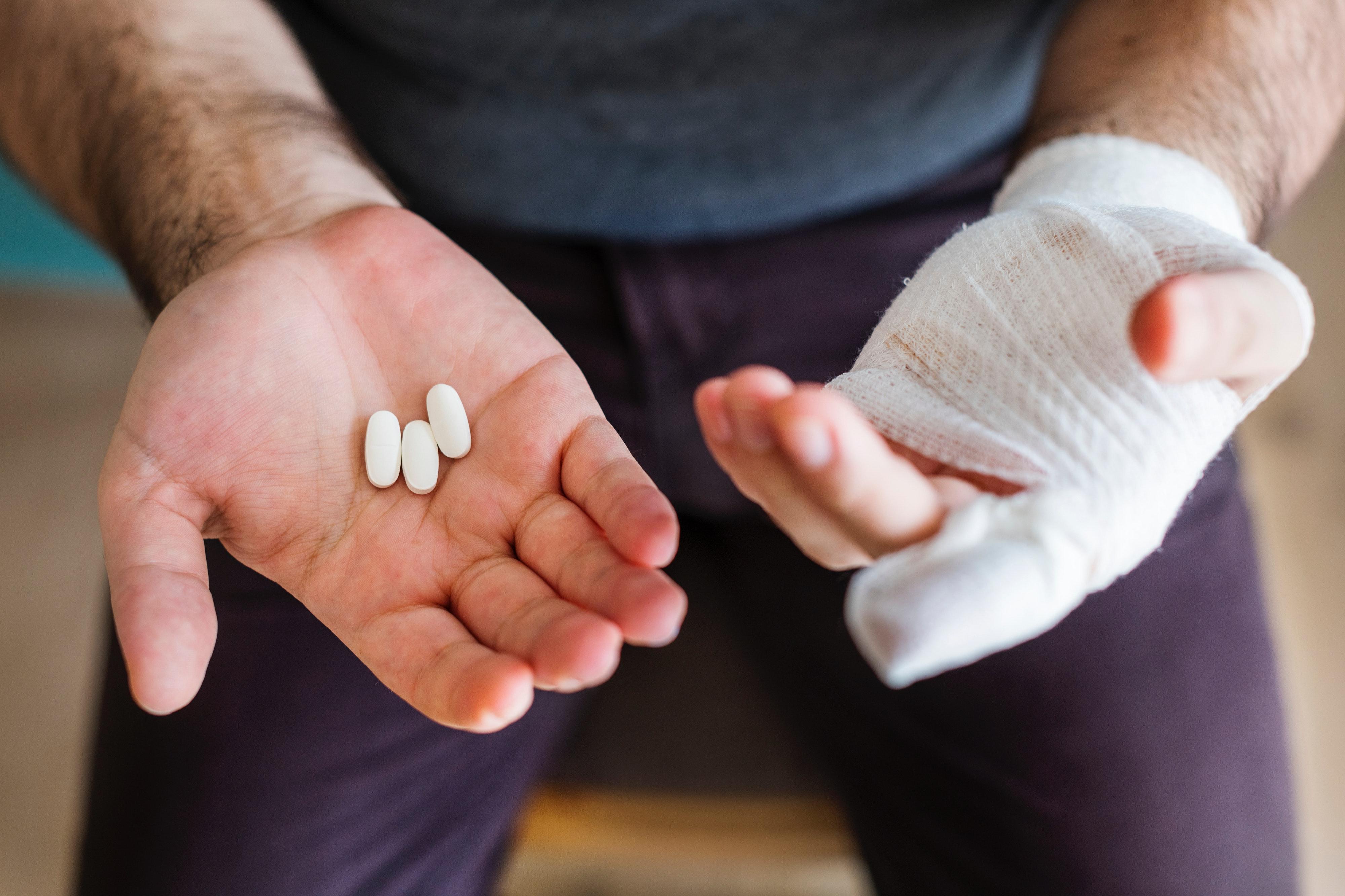 From: https://images.pexels.com/photos/1371172/pexels-photo-1371172.jpeg?cs=srgb&dl=bandage-close-up-drugs-1371172.jpg&fm=jpg, https://www.pexels.com/photo/man-holding-three-white-medication-pills-1371172/